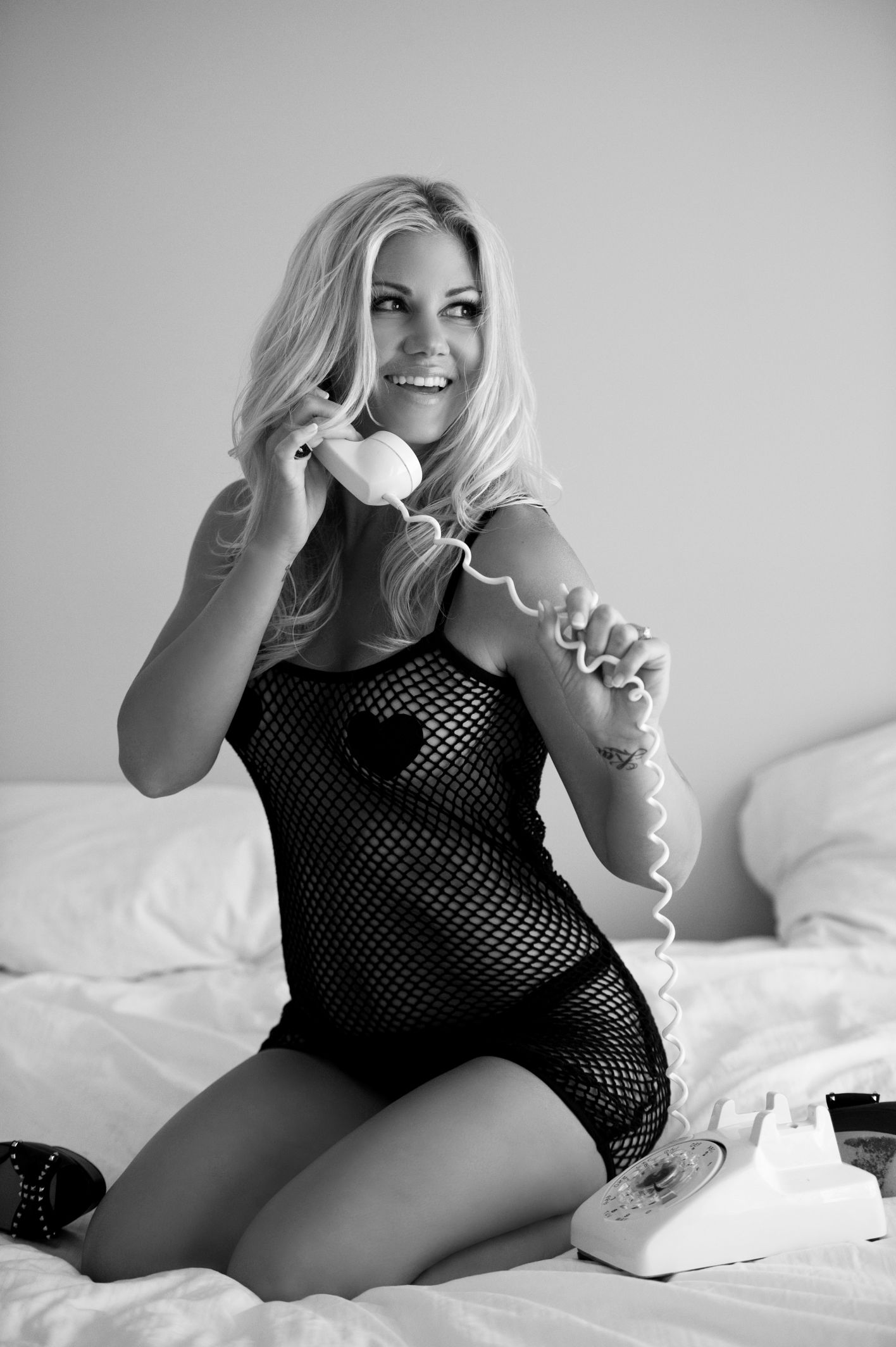 black and white portrait of a gorgeous girl chatting on telephone
